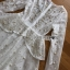 ชุดเดรสเกาหลีพร้อมส่ง เดรสผ้าลูกไม้สีขาวปักมุกตกแต่งระบาย thumbnail 12