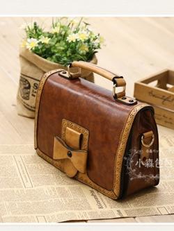 กระเป๋าหนัง pu รุ่นสะพายไหล่ แต่งโบว์ด้านหน้า สีน้ำตาล