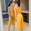 Set เสื้อแขนกุดเอวยืดแต่งโบว์ + กางเกงขาสามส่วน สีเหลือง
